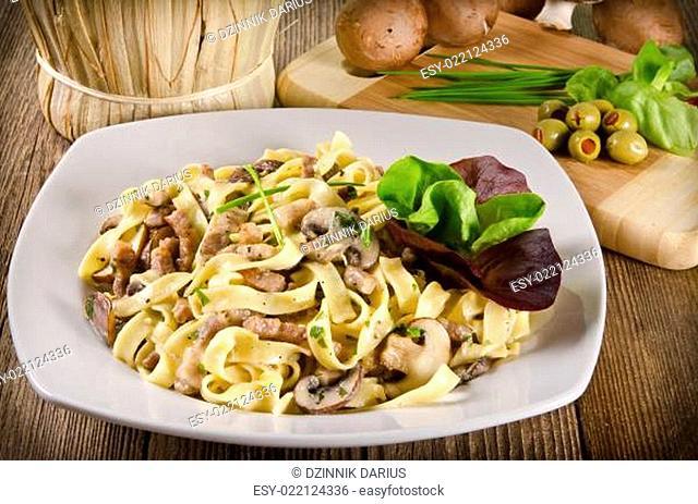 Tagliatelle with tail steak stripe and champignons