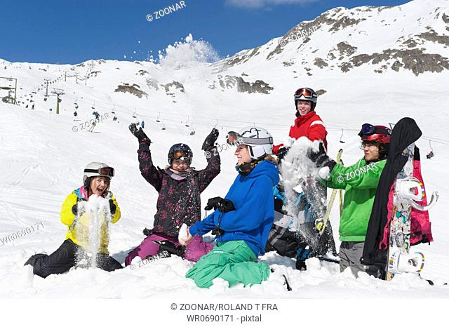 Group of teenager have fun in the snow