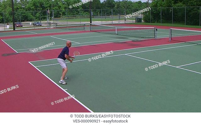 Tennis player volleys using forehand, crane shot