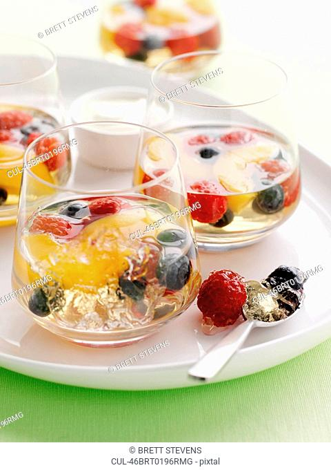 Glasses of fruit salad in gelatin