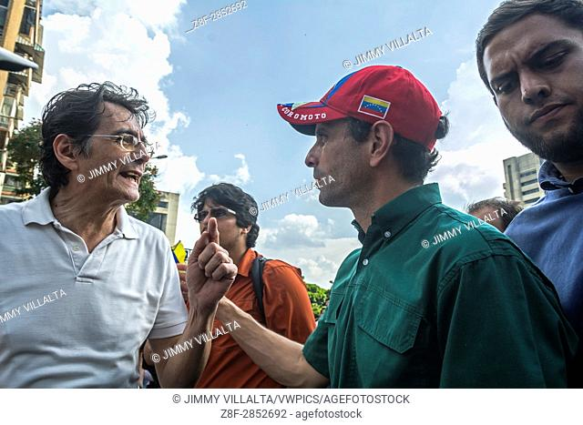 Henrique Capriles Radonski, governor of the Miranda state, and recently politically disabled for 15 years, speaks with a man in homage to the murdered young...