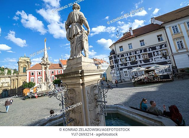 Fountain with statue of Pomona in Mikulov, Czech Republic. View with Holy Trinity Statue, Dietrichstein tomb, Sgraffito house