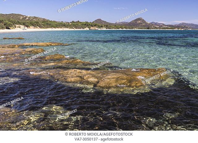 Rocks frame the turquoise water of sea around the sandy beach of Sant Elmo Castiadas Costa Rei Cagliari Sardinia Italy Europe