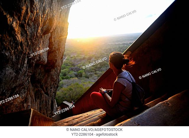 Young woman in the stairs up to the Ancient City of Sigiriya, Sri Lanka