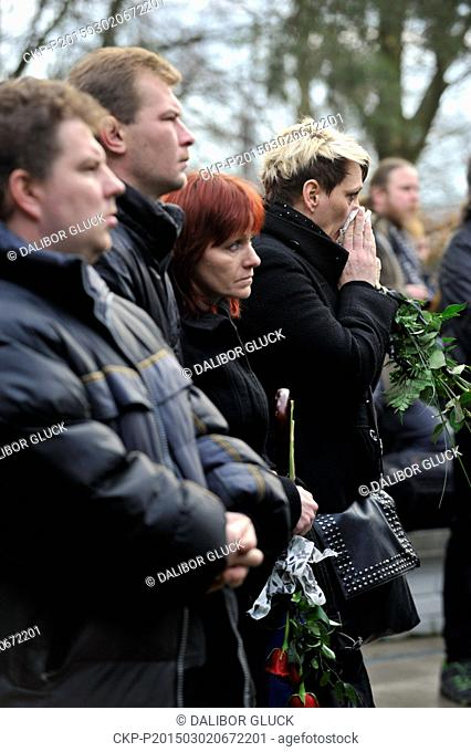 Relatives and citizens of Uhersky Brod attended the funeral of a waitress, 43, the first of eight victims of shooting in a restaurant Druzba in Uhersky Brod