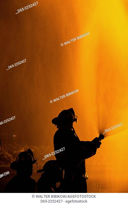 USA, Massachusetts, Cape Ann, Rockport, Fourth of July Bonfire, silhouettes of firemen