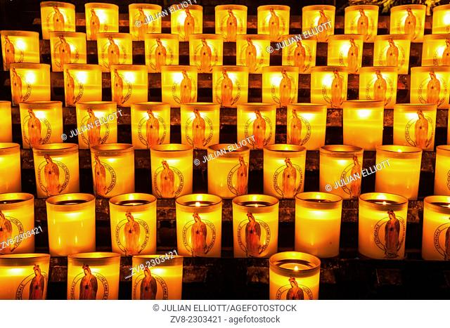 Candles burning in Notre Dame de Paris cathedral
