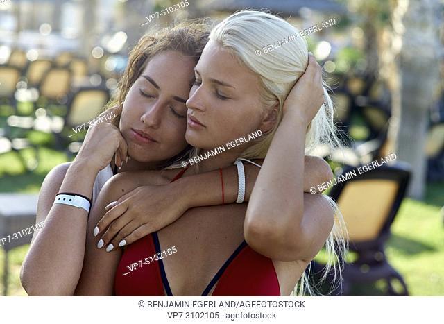 women at holiday resort, embracing, sensual, togetherness, best friends enjoying summer