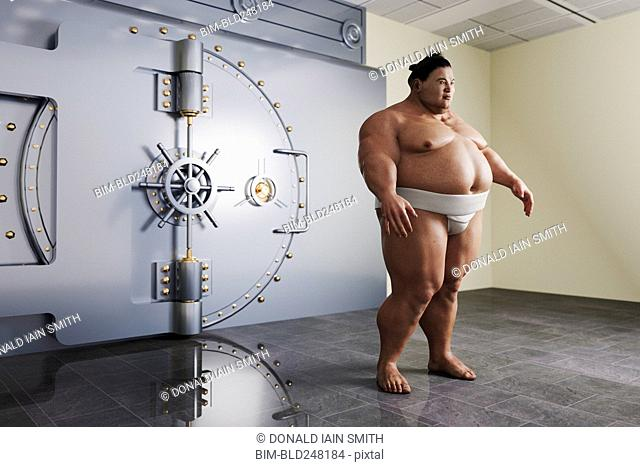 Sumo wrestler guarding vault