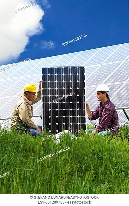 Technicians installing solar panels