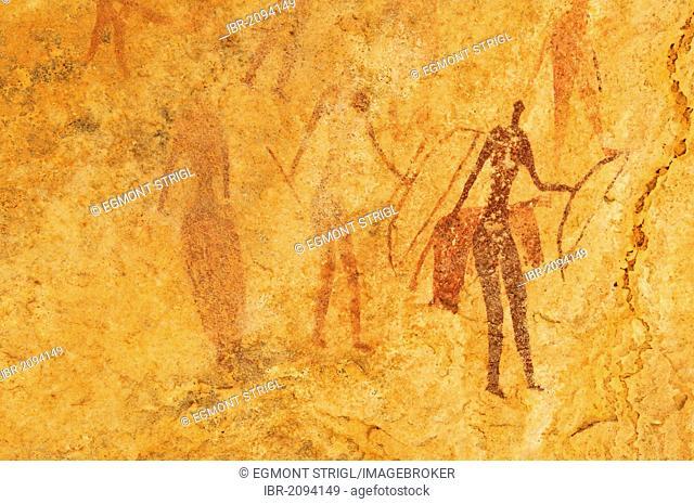Painted warriors or hunters, neolithic rock art at Tin Meskis, Adrar n'Ahnet, Algeria, Sahara, North Africa