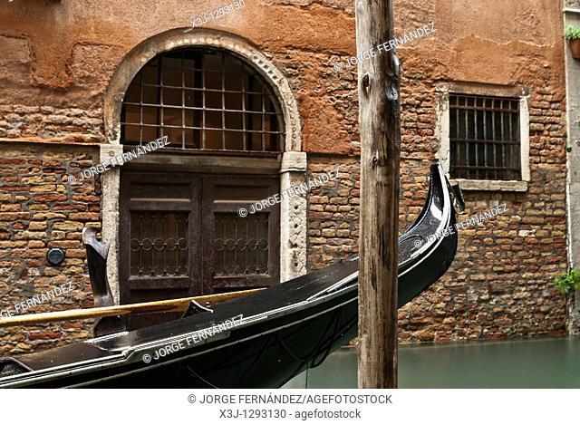 Gondolas and Venetian door, Venice, Italy, Europe