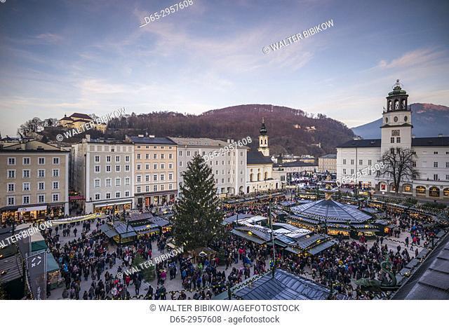 Austria, Salzburgerland, Salzburg, Christmas Market, Residenzplatz, elevated view, dusk