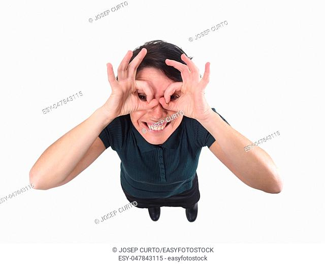 woman looking through fingers as if wearing glasses on white background
