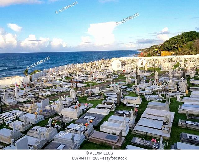 SAN JUAN, PUERTO RICO - SEP, 2017: Overview of the Cementerio de Santa Maria Magdalena de Pazzis cemetery in San Juan, Puerto Rico with the ancient Spanish fort...