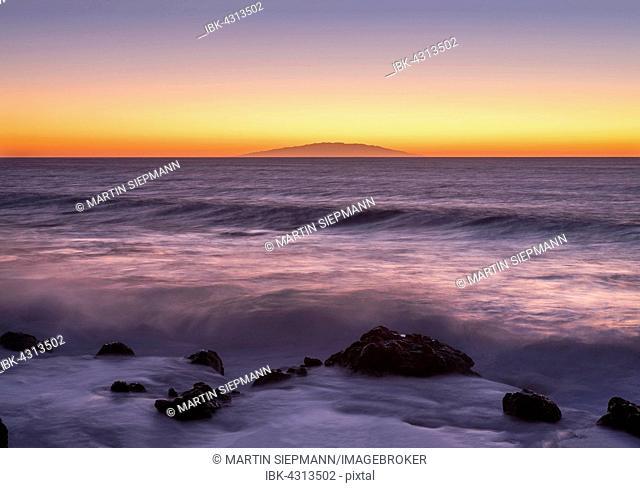Ocean wave at sunset, island of El Hierro behind, Valle Gran Rey, La Gomera, Canary Islands, Spain