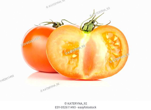 Red tomato section half and one whole with vine ends isolated on white background