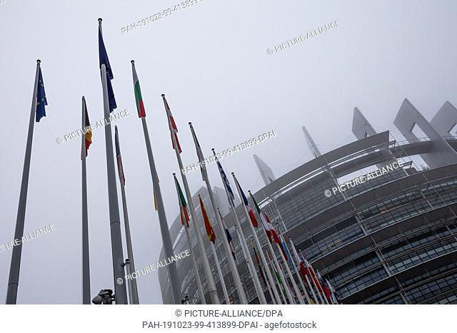23 October 2019, France (France), Straßburg: The flags of the Member States hang on flagpoles in front of the European Parliament building