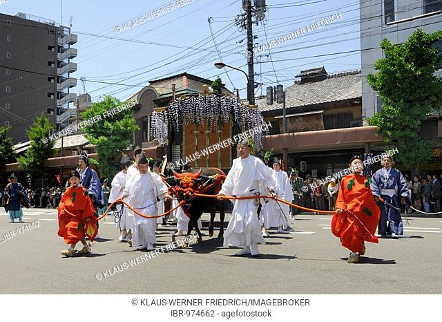 Aoi festival, procession from the Imperial Palace to the Shimogamo Shrine. Oxcart with shrine and japanese men in traditional costumes from the Heian period