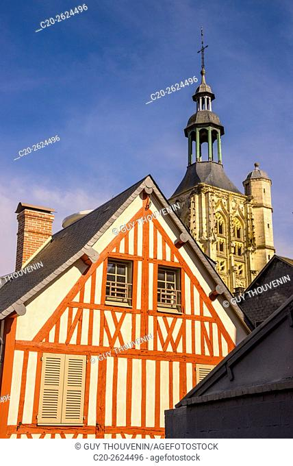 Medieval half timbered house, and Notre Dame de la Couture steeple basilica , in the backlground, Bernay, 27, Normandy, France
