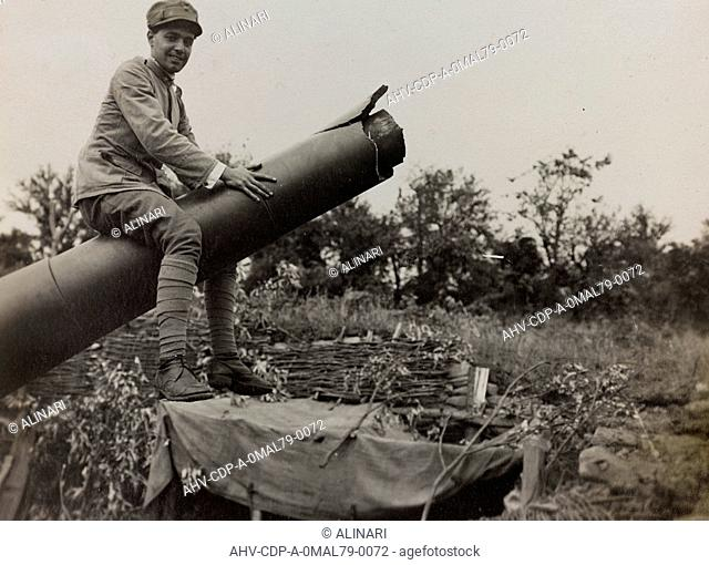 Album Captain Luigi Verdiani - From Florence to Florence through the war, in June 1915 - September 1916: soldier riding a howitzer during the First World War