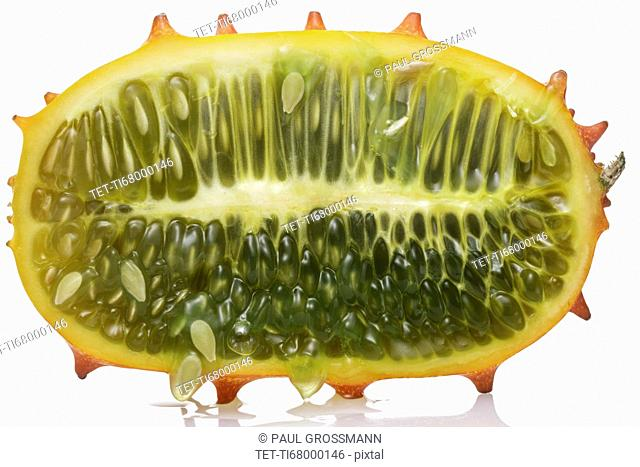 Half of dragonfruit against white background
