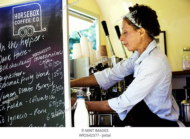 Woman standing in a mobile coffee shop