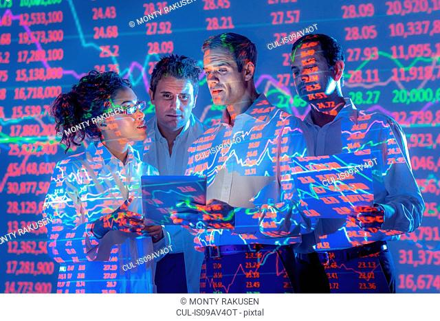 Business people in conversation with graphical projected data