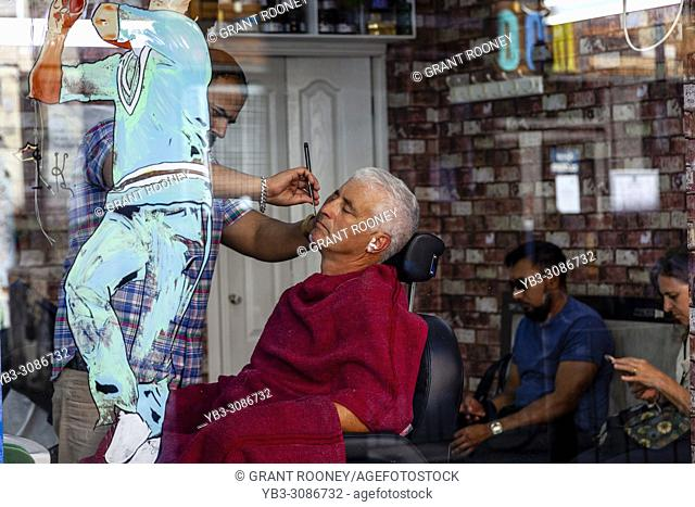 A Man Having A Wet Shave In A Hairdressing Salon, Brick Lane, London, United Kingdom