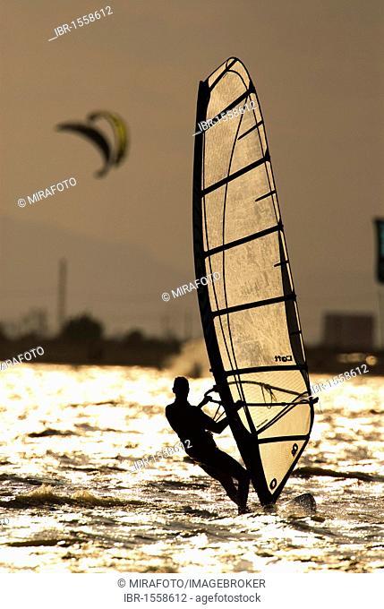 Windsurfer and kite surfer in backlight near the Santa Pola resort, Mediterranean coast, Spain, Europe