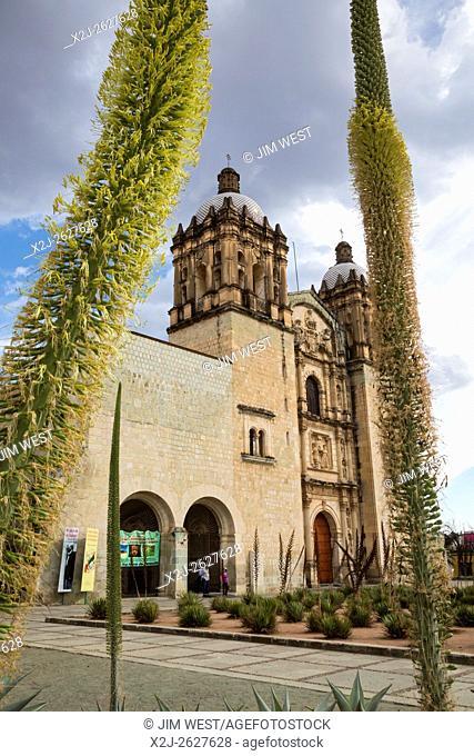 Oaxaca, Mexico - Santo Domingo de Guzmán Catholic Church, framed by flowering agave plants