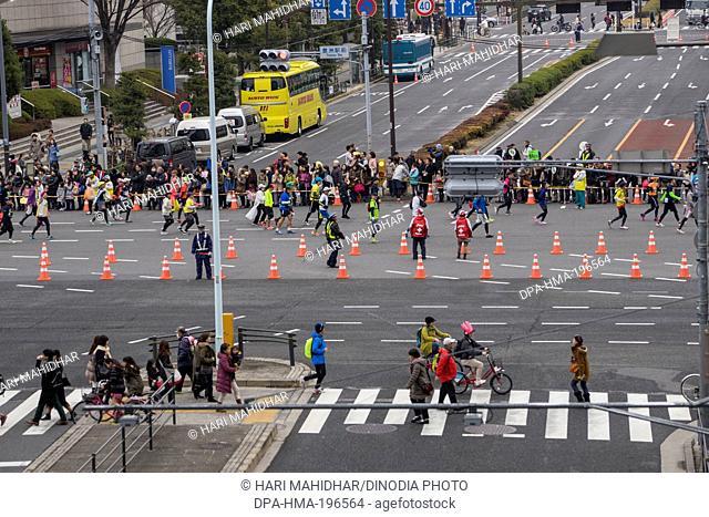 Participants running in marathon, tokyo, japan