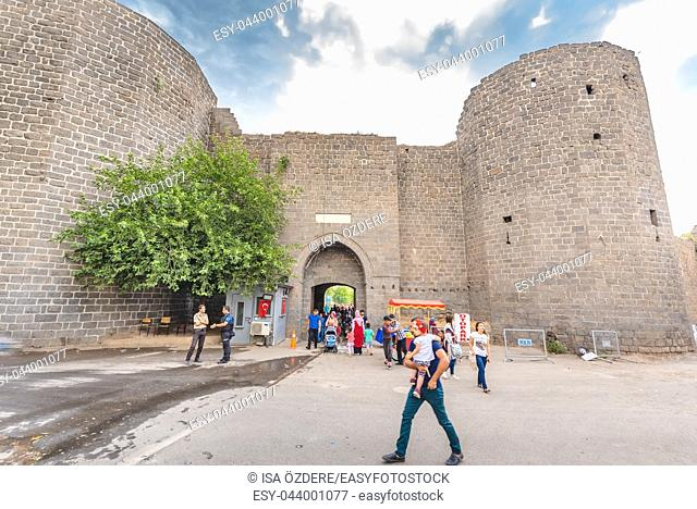 Unidentified people walk around historical gate named as Mardin gate in sur region in central of Diyarbakir,Turkey. 15 July 2018