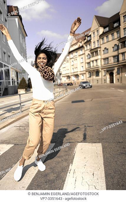 woman running at street
