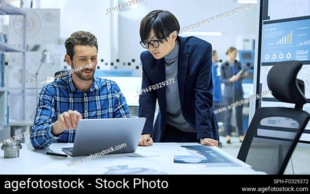 Engineer talking to a project manager