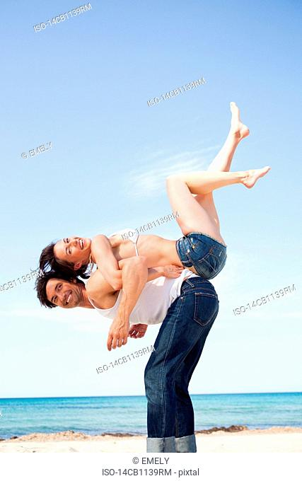 couple on beach playing