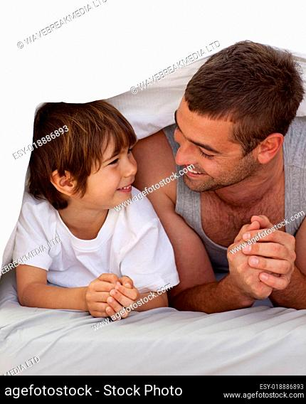 Father and son talking under the bedsheets