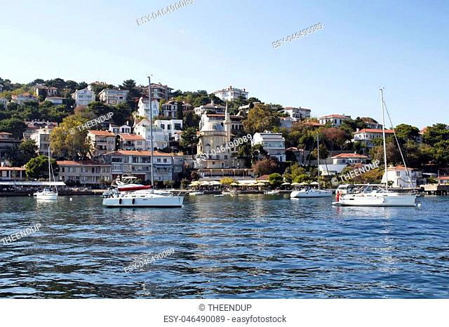 Yachts parked at seaside of Burgazada which is one of Prince Islands in Istanbul. Summer houses mostly owned by minorities and small mosque are in the view