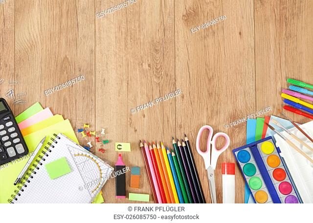 pencils and paper for painting or creative tinkering on wooden background