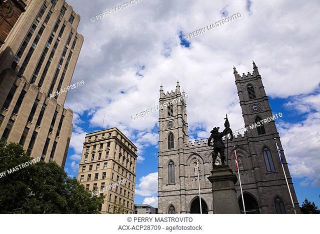 Old Architectural buildings and De Maisonneuve Monument facing the Notre-Dame Basilica, Place d'Armes, Old Montreal, Quebec, Canada