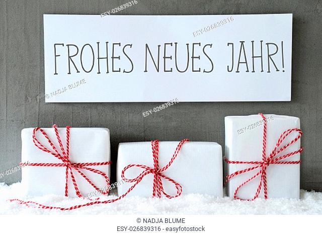 Label With German Text Frohes Neues Jahr Means Happy New Year. Three Christmas Gifts Or Presents On Snow. Cement Wall As Background