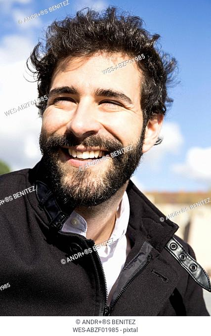 Portrait of smiling young man with full beard