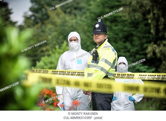Policeman guarding forensic crime scene