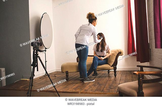 Female photographer recording an interview using voice recorder