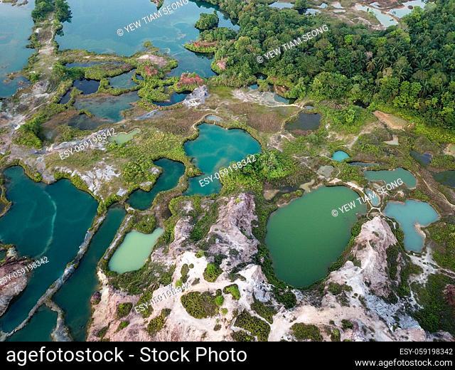 Green lake surround the rock cliff at Guar Petai. Beautiful lake