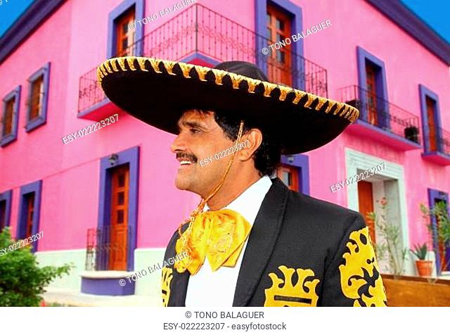Charro mexican Mariachi portrait in pink house