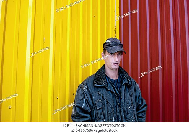 Trucker portrait Lithuania improvements industry farming with colorful company of wheat farming storage area with trucks in Vaunas Lithuania