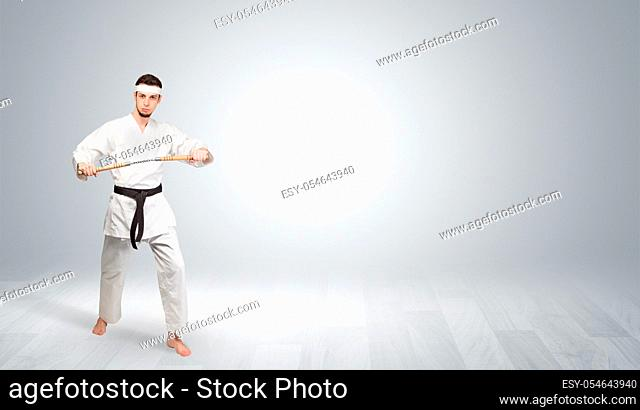 Young kung-fu trainer fighting in an empty space