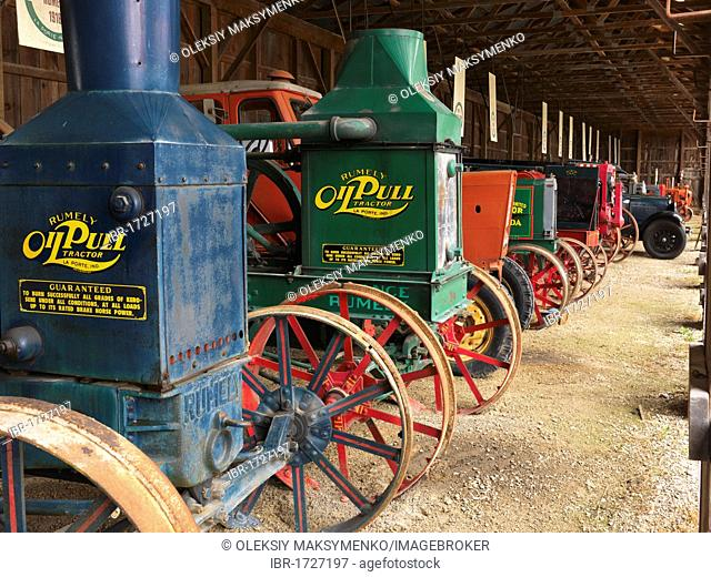 Antique Rumely Oil Pull tractors in a museum of agricultural equipment in Canada