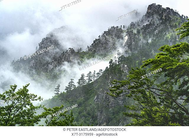 Clouds partially cover the wild and dramatic Albanian Alps, also known as the Accursed Mountains, in The Valbone Valley National Park, North eastern Albania